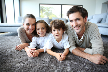 Family at home relaxing on carpet